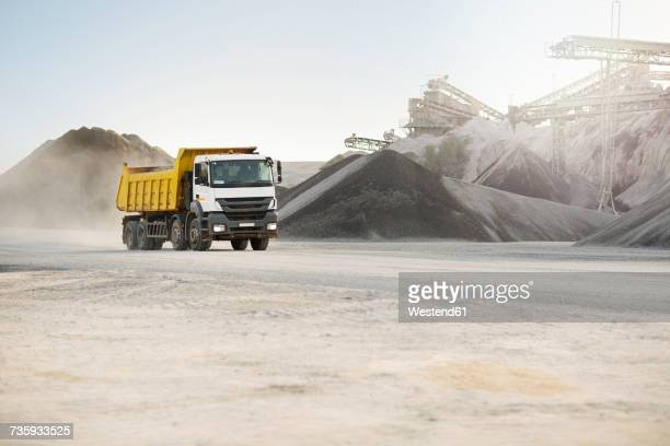 dump truck at quarry - dump truck stock pictures, royalty-free photos & images