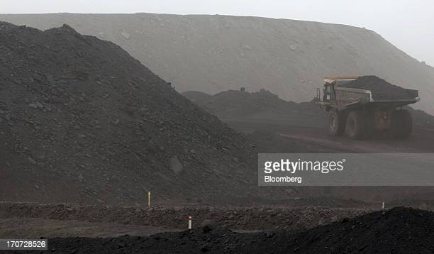 A dump truck carries coal at the open pit in the Tsankhi section of the Tavan Tolgoi coal deposit developed by Erdenes Tavan Tolgoi LLC in South Gobi...