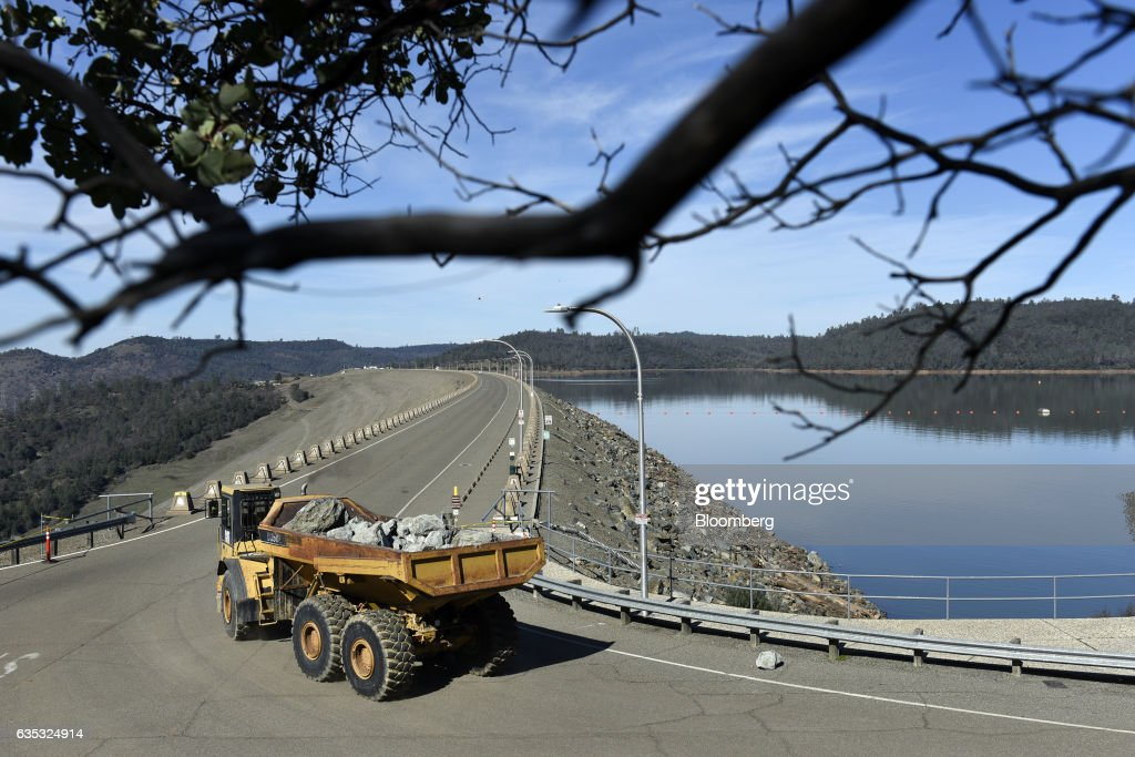 A dump truck carrying boulders heads towards the Oroville