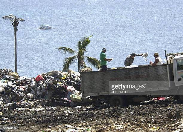 STORY PHILIPPINESTOURISMENVIRONMENTBORACAY A dump truck deposits garbage on a hillside in the central Philippine resort island of Boracay 10 July...