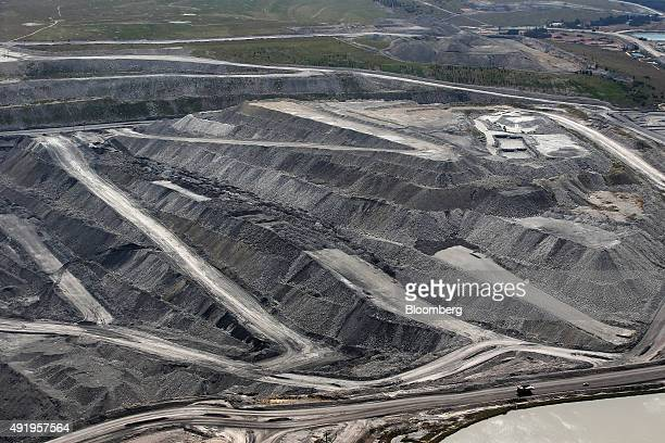 A dump truck drives along a haul road next to an open pit at Glencore Plc's Bulga Coal operations in this aerial photograph taken near Singleton...