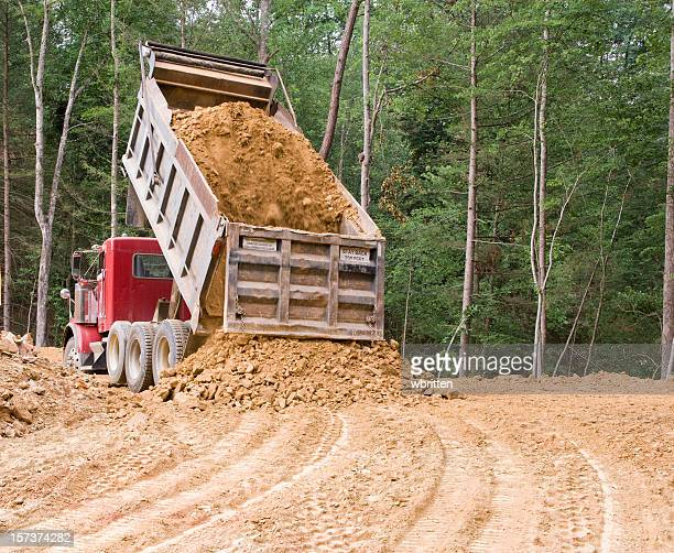 dump truck dumping - dump stock photos and pictures