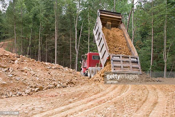dump truck dumping (xxl) - dump truck stock pictures, royalty-free photos & images