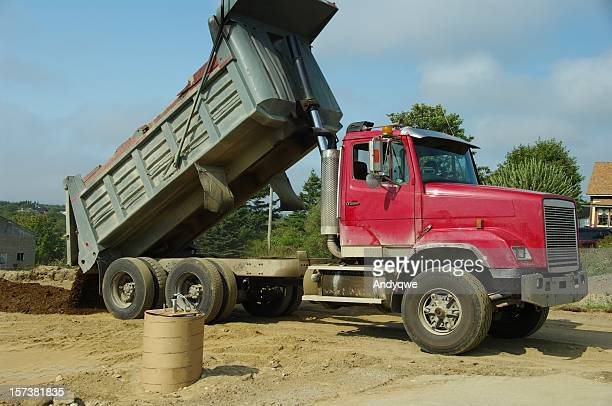 dump truck dumping - dump truck stock pictures, royalty-free photos & images