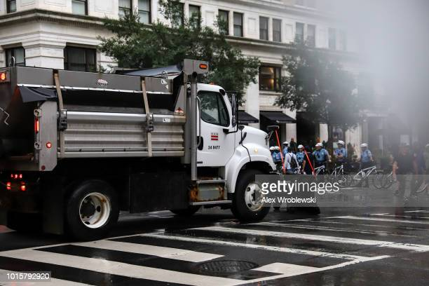 A dump truck is used to block traffic on streets during the Unite the Right rally on August 12 2018 in Washington DC Thousands of protesters are...
