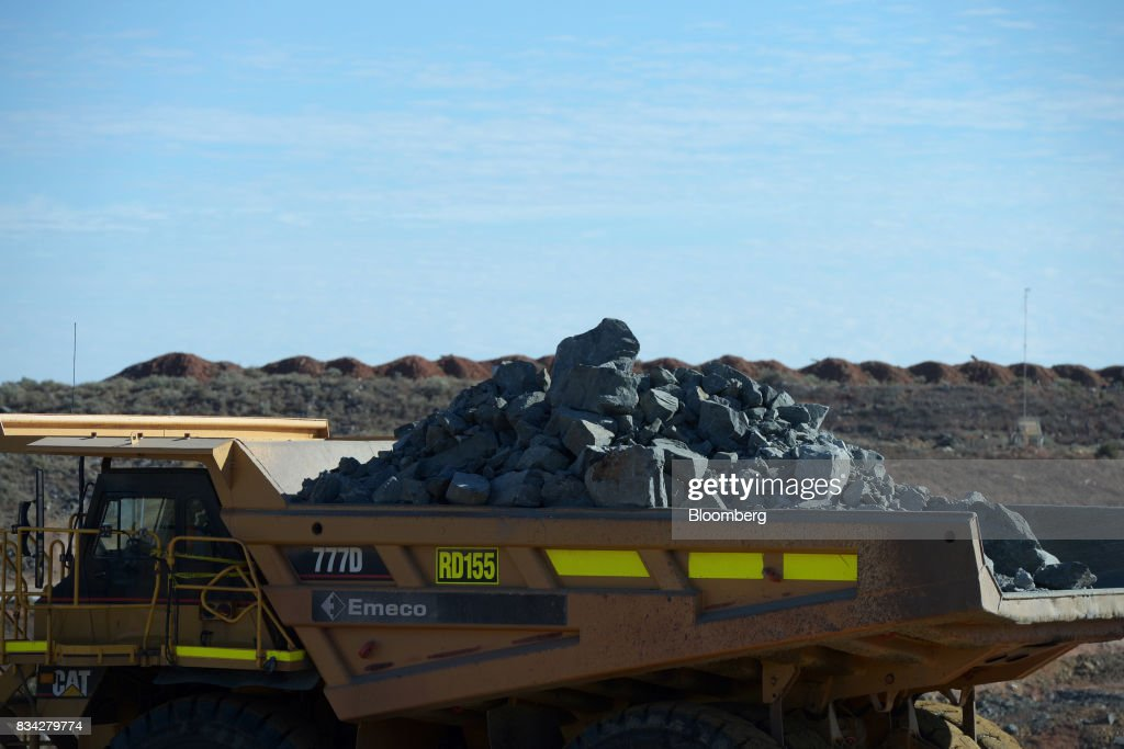 A dump truck laden with ore sits in the White Foil open mine pit at Evolution Mining Ltd.'s gold operations in Mungari, Australia, on Tuesday, Aug. 8, 2017. Evolution Mining is Australias second-largest gold producer. Photographer: Carla Gottgens/Bloomberg via Getty Images