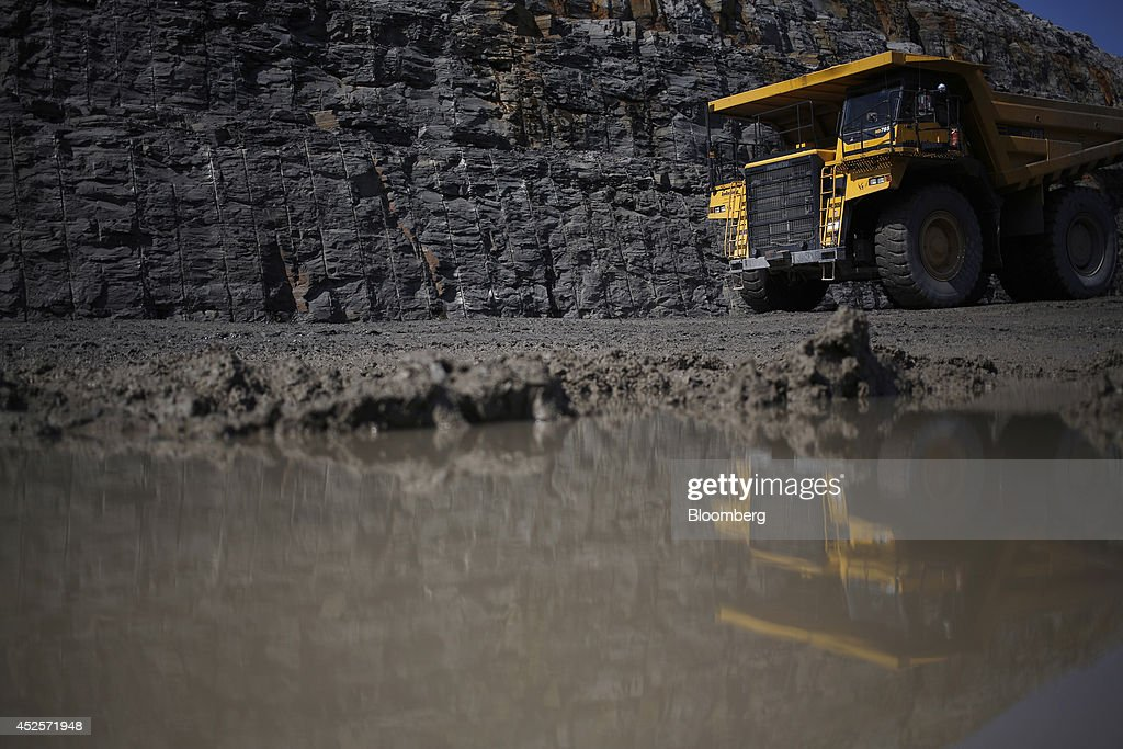 A dump truck moves a load of rock blasted out from a new segment of U.S. Highway 460, part of the Appalachian Development Highway System, under construction near the Virginia border in Elkhorn City, Kentucky, U.S. on Tuesday, July 22, 2014. Senate Democrats may bring to the floor a House-passed measure that would replenish federal funds for highway and mass-transit projects through May 2015. As part of that debate, senators could vote on two Democratic alternatives, although leaders say the House measure is more likely to prevail. Photographer: Luke Sharrett/Bloomberg via Getty Images