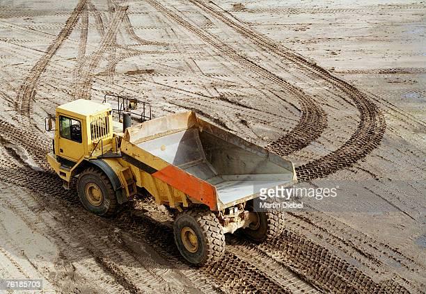Dump truck on muddy ground