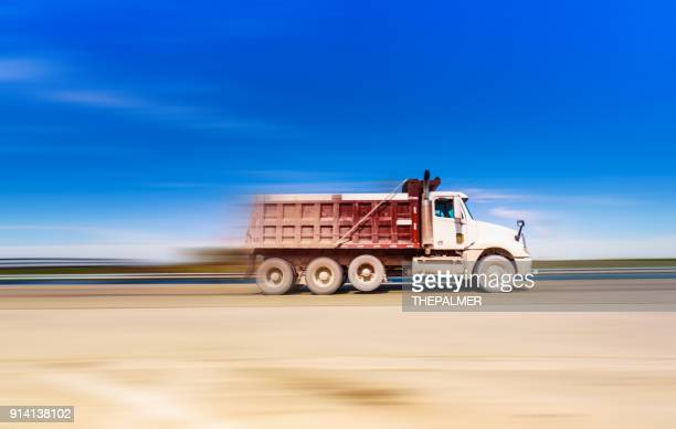 dump truck on the highway - dump truck stock pictures, royalty-free photos & images