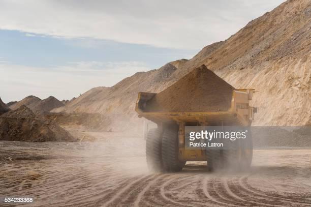 Dump Truck Rolling on Dirt Road in Open Phosphate Mine