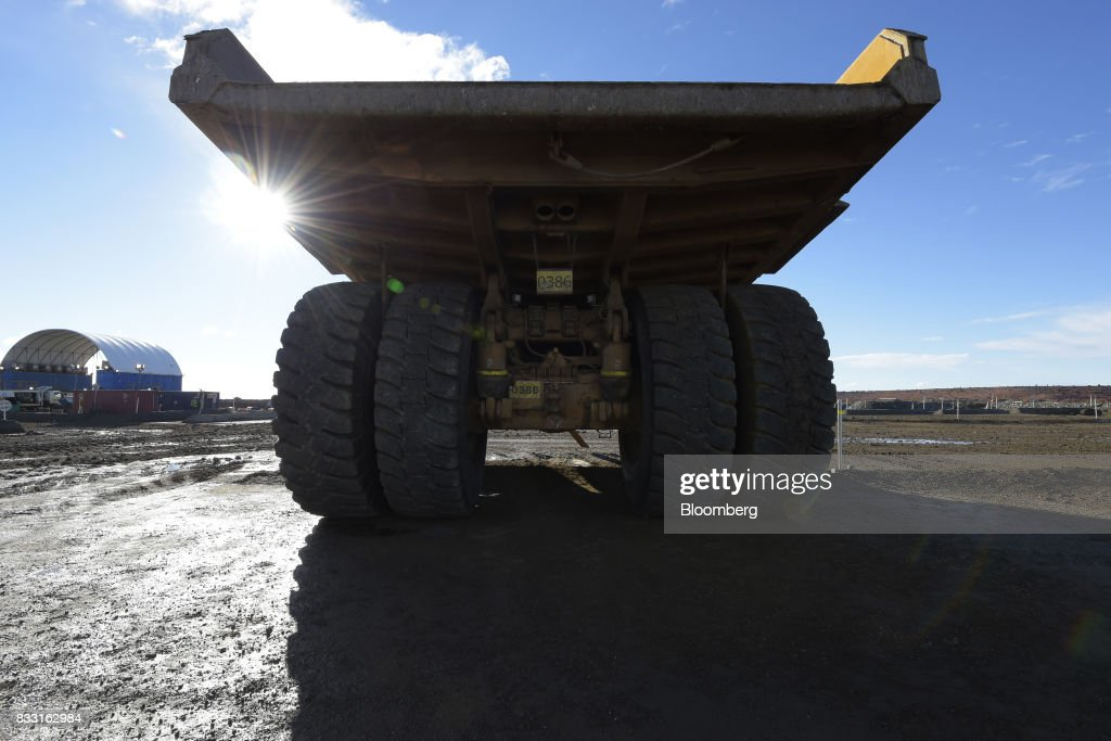A dump truck sits parked in a workshop area of the St Ives Gold Mine operated by Gold Fields Ltd. in Kambalda, Australia, on Wednesday, Aug. 9, 2017. Global gold deals have also slowed, declining to $19.8 billion in 2016 from $22.8 billion a year earlier, according to data complied by Bloomberg. Photographer: Carla Gottgens/Bloomberg via Getty Images