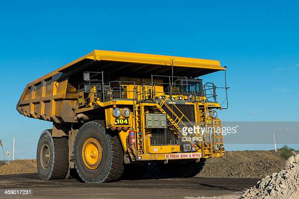 dump truck travelling on a haul road - komatsu stock pictures, royalty-free photos & images