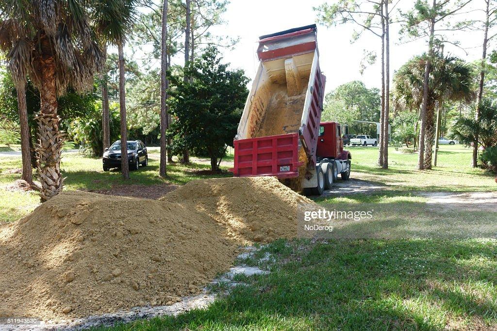 Dump Truck Unloading Fill Dirt Stock Photo