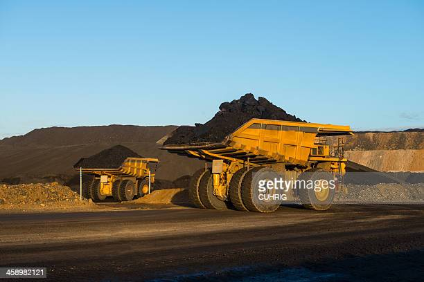 dump truck with coal on a haul road - komatsu stock pictures, royalty-free photos & images