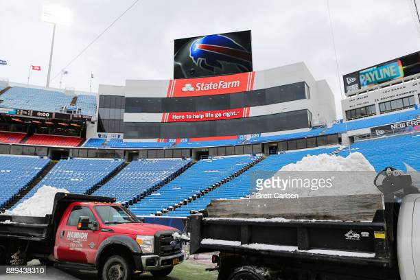 Dump trucks haul snow off of the field before a game between the Indianapolis Colts and Buffalo Bills on December 10 2017 at New Era Field in Orchard...