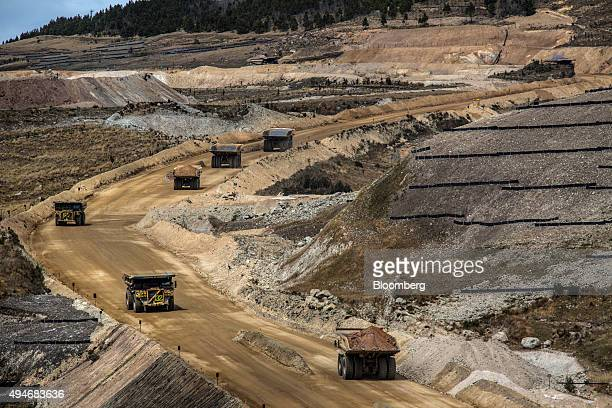 Dump trucks haul soil away from a pit at the Yanacocha gold mine in Cajamarca Peru on Thursday Oct 15 2015 Operations at Yanacocha South America's...