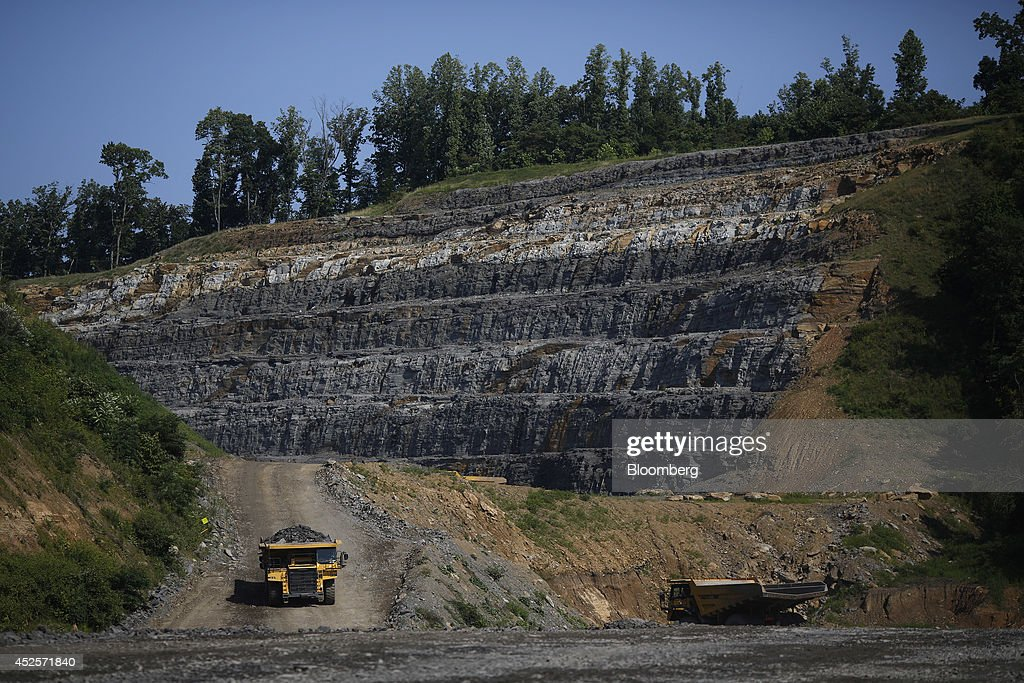 Dump trucks move loads of rock blasted out from a new segment of U.S. Highway 460, part of the Appalachian Development Highway System, under construction near the Virginia border in Elkhorn City, Kentucky, U.S. on Tuesday, July 22, 2014. Senate Democrats may bring to the floor a House-passed measure that would replenish federal funds for highway and mass-transit projects through May 2015. As part of that debate, senators could vote on two Democratic alternatives, although leaders say the House measure is more likely to prevail. Photographer: Luke Sharrett/Bloomberg via Getty Images