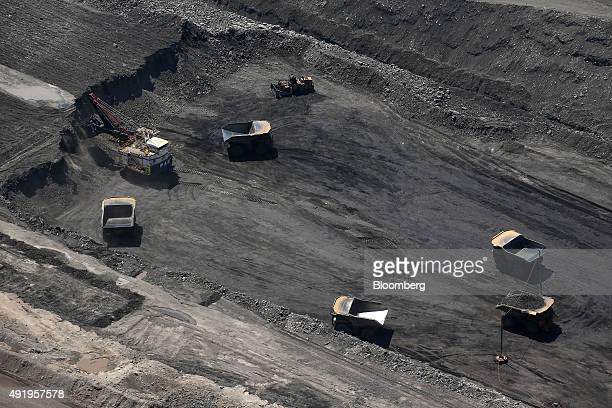 Dump trucks operate in an open pit at Glencore Plc's Bulga Coal operations in this aerial photograph taken near Singleton Australia on Saturday Oct 3...