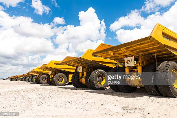 dump trucks parked up from behind - komatsu stock pictures, royalty-free photos & images