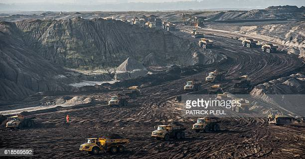 Dump trucks transport earth in the former CottbusNord opencast mine near Cottbus east Germany on October 27 2016 / AFP / dpa / Patrick Pleul /...