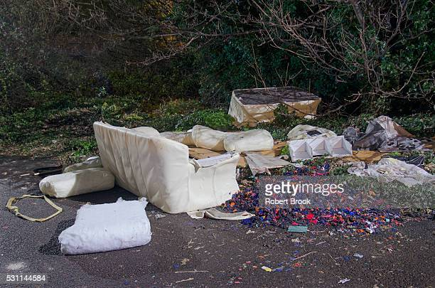 dumped furniture in street at night - garbage dump stock pictures, royalty-free photos & images