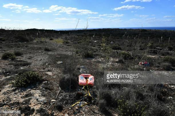 TOPSHOT A dumped life jacket from Spanish NGO Astral is pictured in the socalled boat cemetery where skiffs are dumped after the migrants and...