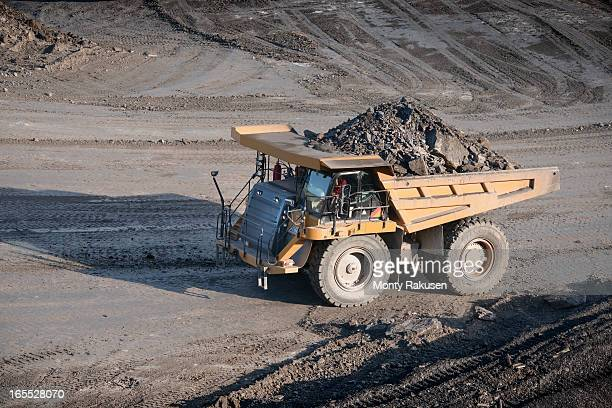 Dumper containing rocks at surface coal mine, high angle