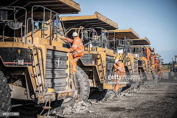 Dumper truck drivers climb down for break at surface coal mine
