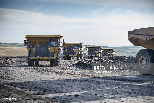 Dumpers driving on track at surface coal mine