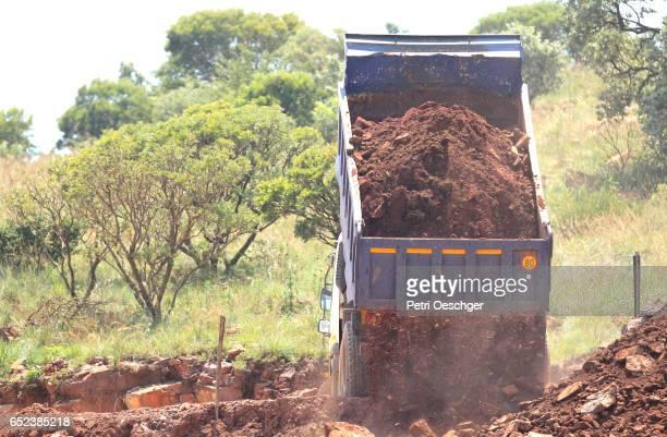 Dumping Dirt.