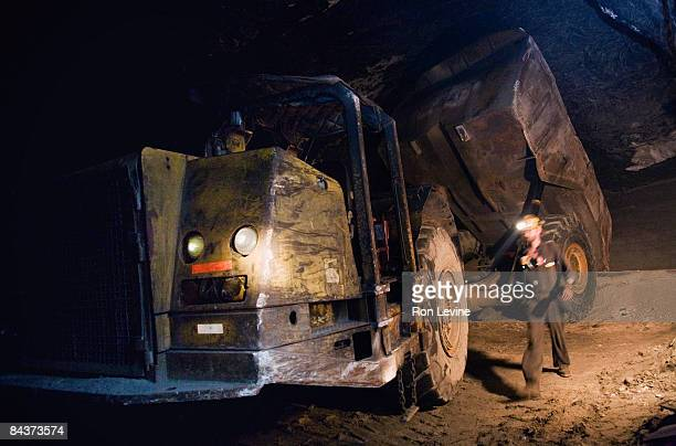 dumping excess rock at a zinc mine - underground mining stock photos and pictures