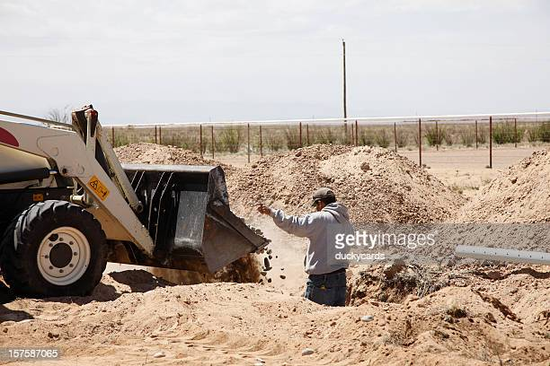 dumping rocks in new drain field for septic system - septic tank stock photos and pictures