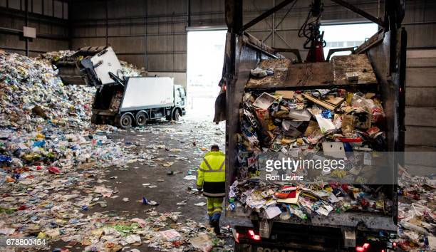dumping trucks at a recycling plant