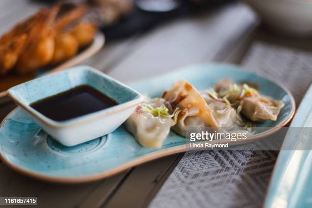 dumpling - soy sauce stock pictures, royalty-free photos & images