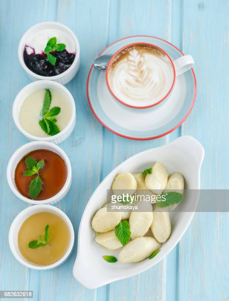Dumpling with sauce and cup of coffee