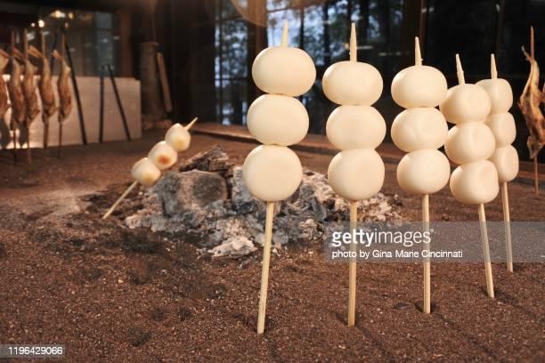 dumplings dango roasting near an open fire - 栃木県 ストックフォトと画像