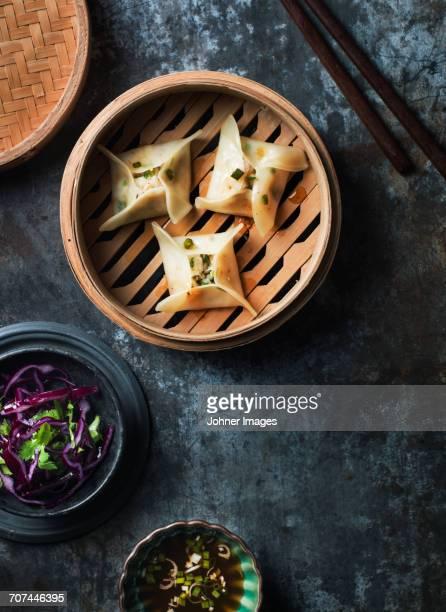 Dumplings in steam basket