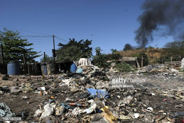 Dumps of garbage can be seen to crude dwellings in the slums of Gramacho in Rio de Janeiro Brazil 13 August 2016 Here hundreds of people live in...