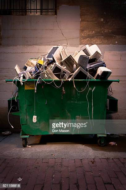 dumpster full of computer equipment - garbage bin stock pictures, royalty-free photos & images
