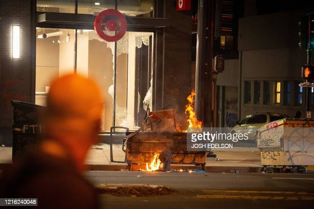 A dumpster is lit on fire infront of a Target store in Oakland California on May 30 over the death of George Floyd a black man who died after a white...