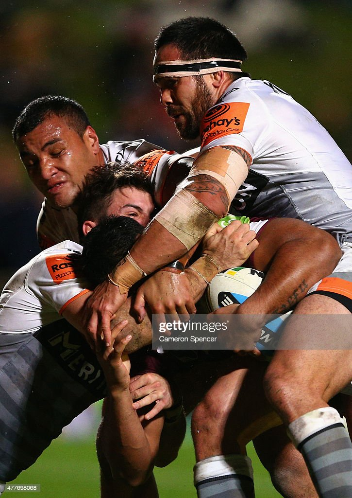 Dunamis Lui of the Sea Eagles is tackled during the round 15 NRL match between the Manly Sea Eagles and the Wests Tigers at Brookvale Oval on June 19, 2015 in Sydney, Australia.