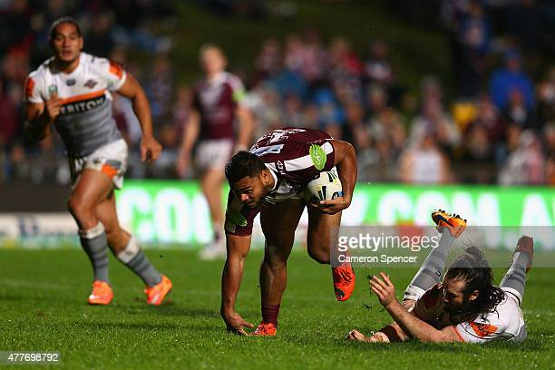 Dunamis Lui of the Sea Eagles makes a break during the round 15 NRL match between the Manly Sea Eagles and the Wests Tigers at Brookvale Oval on June...