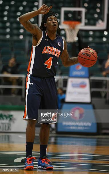 J Dunans of the Auburn Tigers gestures and calls out a play against the New Mexico Lobos at the Stan Sheriff Center during the Diamond Head Classic...
