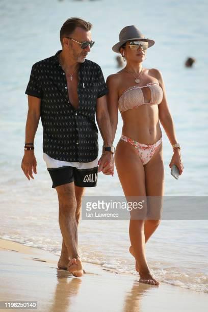 Duncan and Nigora Bannatyne seen walking along the beach outside Sandy Lane Hotel on December 27 2019 in Bridgetown Barbados