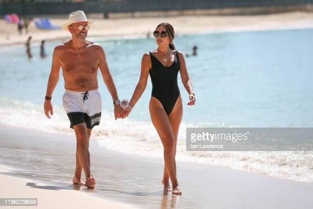 Duncan Bannatyne and Nigora Bannatyne seen walking and swimming in the sea outside Sandy Lane Hotel on December 27 2019 in Bridgetown Barbados