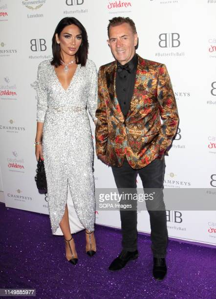 Duncan Bannatyne and Nigora Whitehorn arrive for the Caudwell Children Butterfly Ball charity event at the Grosvenor House Park Lane
