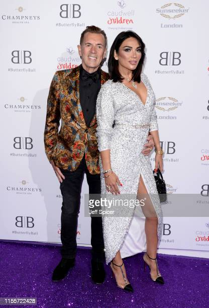 Duncan Bannatyne and Nigora Whitehorn attend the Caudwell Children Butterfly Ball 2019 at The Grosvenor House Hotel on June 13 2019 in London England