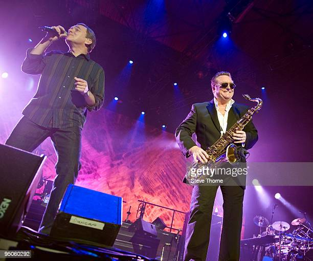 Duncan Campbell and Brian Travers of UB40 perform on stage at LG Arena on December 21 2009 in Birmingham England