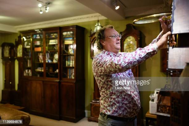 Duncan Clements of Pendulum of Mayfair antique clock specialists carries out the summertime adjustment of the clocks regulators and timepieces in the...