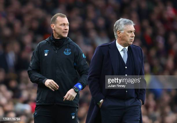 Duncan Ferguson and Carlo Ancelotti Manager of Everton look on during the Premier League match between Arsenal FC and Everton FC at Emirates Stadium...
